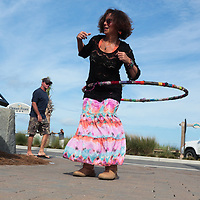 Suzi McLean of Wilmington hula hoops Sunday July 13, 2014 during Boogie in the Park at Kure Beach, N.C. (Jason A. Frizzelle)