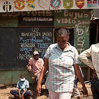 Beatrice walks along Biashara Street, one of the main business corridors in Mathare.