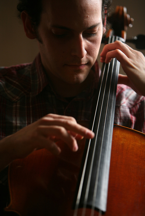 Musician Mike Block playing cello in his apartment in Manhattan, New York on May 01, 2011. The Julliard-trained cellist and composer is bringing a new performance series GALA/NYC to the Brooklyn Lyceum in Park Slope..CREDIT: Melanie Burford/Prime for The Wall Street Journal..Slug: NYMIKEBLOCK