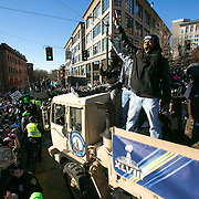 Seattle Seahawks cornerback Richard Sherman cheers as he is surrounded by hundreds of thousands of fans during the Super Bowl Championship Parade on Wednesday, February 5, 2014 in downtown Seattle. An estimated 700,000 people came out to celebrate with Seattle's championship team.