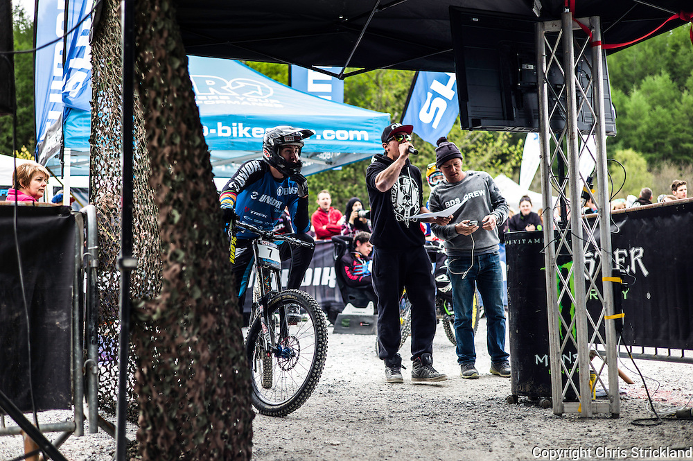 Nevis Range, Fort William, Scottish Highlands, UK. 15th May 2016. Reece Wilson looks at the live results after his race run at the British Downhill Series on Nevis Range in the Scottish Highlands.