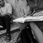 Woman sketch artist watched by man, Spanish Steps, Rome, Italy
