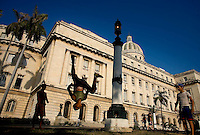 cuban doing acrobatics in street in front of beautiful building