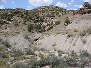 USA: Colorado: Montrose County: Old West road bed with rock culvert along SR 90 near Naturita, Colorado. Original trails and roadbeds run alongside today's highways in much of the western U.S.