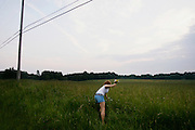 Melissa Turk, 19, picks flowers on July 1, 2006 in Eastlake, Ohio.