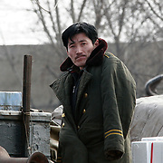 A North Korean man stands on the bank of the Yalu river in Sinuiju, North Korea, on Thursday, Feb. 8, 2007. The Six Party talks have started on the 8th of February in Beijing with the hope of terminating the nuclear program of North Korea