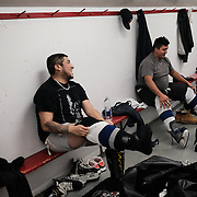 Fabian Blackhawk (left) and Marvin Roulette of the Ochiichagwe'Babigo'Ining Ojibway Nation (also known as the Dalles First Nation) in Northern Ontario, Canada, getting ready for an ice hockey game with friends at the Recreation Centre in the town of Kenora, about 30 minutes drive from the nation's reserve, on 15 December 2016.