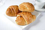 A plate with three croissants