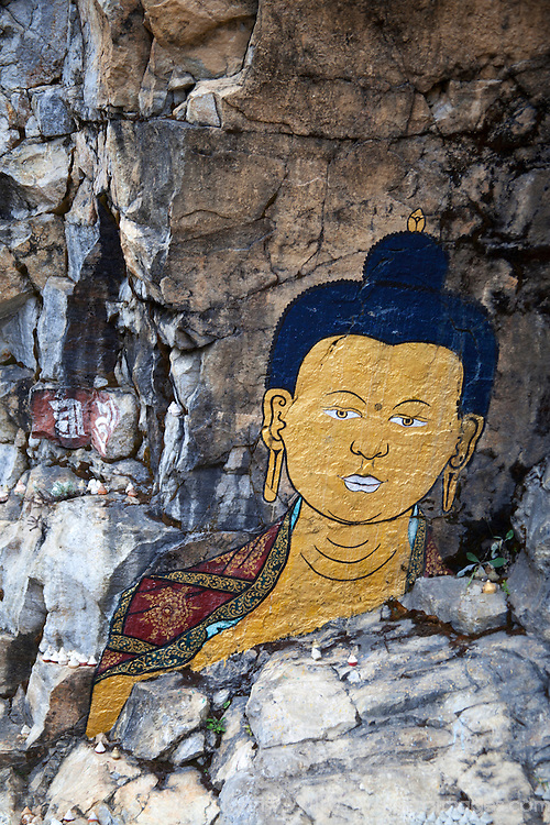 "Asia, Bhutan, Trongsa. Rock Painting Scene from ""Travelers and Magicians"" movie."