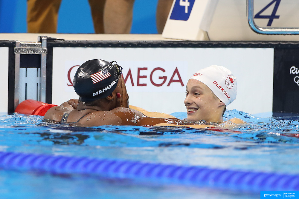Swimming - Olympics: Day 6   Simone Manuel of the United States who dead heated with Penny Oleksiak of Canada to both win the gold medal in the Women's 100m Freestyle Final during the swimming competition at the Olympic Aquatics Stadium August 11, 2016 in Rio de Janeiro, Brazil. (Photo by Tim Clayton/Corbis via Getty Images)