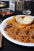 Cholent or hamin is a traditional Jewish stew simmered overnight, for 12 hours or more, and eaten for lunch on the Sabbath.