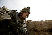 Pinned down under enemy fire and face bloodied by shrapnel Sargeant Michael Clark of the 82nd Airborne, 1/508, Alpha Company, Third Platoon searches for the enemy position in Sangin, Helmand province, Afghanistan on Thursday, April 5, 2007. The firefight, less than 24 hours into the air assault on Sangin raged for over five hours.