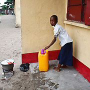Kinshasa, DRC. March 2009. UNICEF provides access to clean water and sanitation services at shools in the DRC. In the DRC UNICEF also helps procure supplies like school-in-a-box, a pre-packaged kit of materials like exercise books, pencils, erasers and scissors, enough for a teacher and up to 80 students.