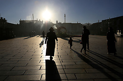 A picture made available on 19 September 2016 of Tibetan pilgrims walking to the Jokhang Temple in the early morning in Lhasa, Tibet Autonomous Region, China, 09 September 2016. Jokhang Temple is considered one of the most sacred site for Tibetan buddhists built during the rule of King Songtsen Gampo in the 7th century.