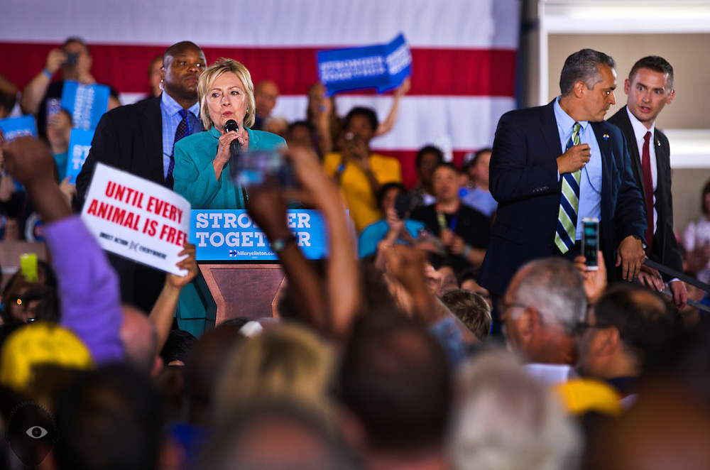 Secret Service agents take the stage as Democratic nominee for President Hillary Clinton continues to speak during a rally to talk about plans for growing the economy and other concerns at IBEW Local 357 on Thursday, August 4, 2016. Animal rights activists unfurled a banner and attempted to disrupt the event and there was some momentary concern.  L.E. Baskow
