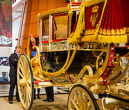 THE HAGUE - King Willem-Alexander looks at the Louwman Museum's restored glass coach glazen koets . The special carriage, the oldest of the royal stable department, the next time will be exhibited in the museum .COPYRIGHT ROYALS BY ROBIN/marco de swart<br />