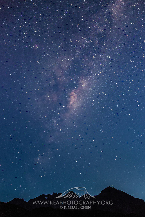 At dawn, Milky Way stretches out over a increasingly blue canvas at Mount Cook National Park, New Zealand