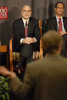 Chairman of the Federal Reserve Board of the United States Ben Bernanke (left) makes listens to Ohio State President E. Gordon Gee at the 'Conversation on the Economy,' a forum held at Pfahl Hall in the Fisher College of Business at Ohio State on Nov. 30, 2010..