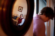 Linda Groeber, 67, watches as her grandson Evan Brown, 13, returns from taking out the trash during a family visit in Lutherville-Timonium, Maryland on Wednesday, January 13, 2010. As she ages Linda has relied more on her daughters Tracey Brown and Annie Groeber to help with day-to-day tasks.