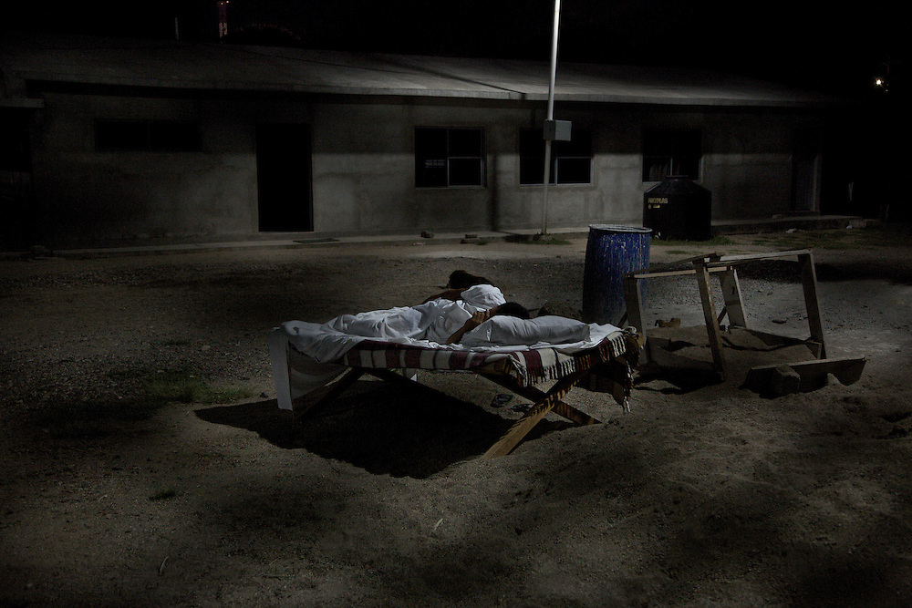 Most nights it's impossible to sleep because of the awful mosquitos. Many of the migrants prefer to sleep outdoors covered by a large sheet. Ixtepec-Oxaca-Mexico,2011