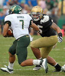 Linebacker Manti Te'o (5) sets his sights on South Florida Bulls quarterback B.J. Daniels.