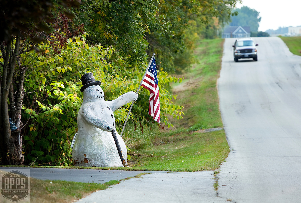 Snowman and American flag on Sleepy Hollow Rd in Kewaunee County.