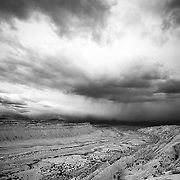 A thunderstorm moves over the striking landscape of Strike Valley in Utah's Escalante Region.