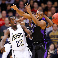 SOUTH BEND, IN - DECEMBER 21: Jerian Grant #22 of the Notre Dame Fighting Irish passes the ball around Juan'ya Green #10 of the Niagara Purple Eagles at Purcel Pavilion on December 21, 2012 in South Bend, Indiana. (Photo by Michael Hickey/Getty Images) *** Local Caption *** Jerian Grant; Juan'ya Green