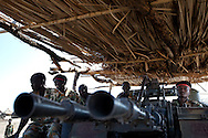 An anti-aircraft gun covered by grass thatch points across the border at SAF posistions in most northern barracks in Upper Nile State.