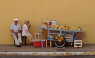 Husband and wife fruit stand in downtown Asuncion, Paraguay on Wednesday, March 8, 2006.