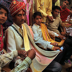 Bridegrooms Hariprasad, 22 at left, and Kishore, 13 at right, gather to bring their wives to their new homes the day after Akshaya Tritiya, the Hindu holy day, which is called Akha Teej in Rajasthan, India on April 29, 2009.