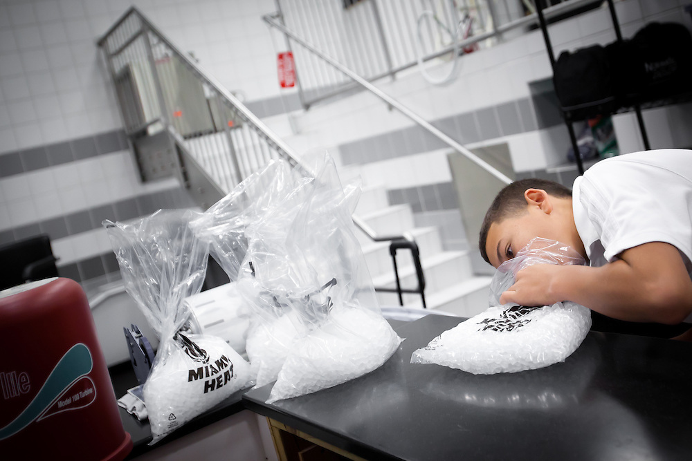 MIAMI, FL -- January 29, 2012 -- Miami ball boy Rafi Jaffet, 14, sucks air out of ice packs in the Heat's locker room prior to their 97-93 win over the Chicago Bulls at American Airlines Arena in Miami, Fla., on Sunday, January 29, 2012.  (Chip Litherland for ESPN the Magazine)