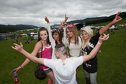 Shirley McNeil, Samantha McNeil Jess Beatie and Rebecca McLean. & Duncan Williamson, fans at Rockness main area..Rockness, Saturday 12th June 2010..Pic ©2010 Michael Schofield. All Rights Reserved.