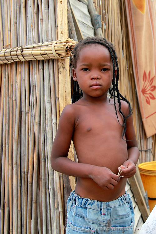 Africa, Botswana, Okavango Delta. Delta girl growing up in a village in the Okavango.