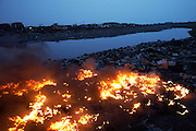 Monitor casings and other plastic burn along the edge of Agbogbloshie dump, in Accra, Ghana. At theses burning sites concentrations of toxic metals have been found at over one hundred times the normal level.