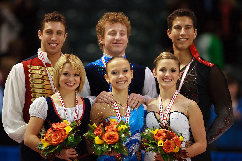 20101030 -- Kingston, Ontario -- Gold medalists Lubov Iliushechkina and Nodari Maisuradze of Russia, centre, pose for photographs with silver medalists Kirsten Moore-Towers and Dylan Moscovitch of Canada and bronze medalists Paige Lawrence and Rudi Swiegers of Canada  during the medal ceremony for the pairs competition at Skate Canada International in Kingston, Ontario, Canada, October 30, 2010. <br /> AFP PHOTO/Geoff Robins