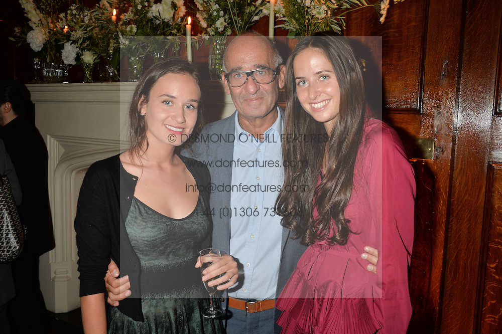 DIDIER KRZENTOWSKI Director of Galerie Kreo and his daughters CLARA KRZENTOWSKI and VICTOIRE KRZENTOWSKI at a party to celebrate opening of Galerie Kreo in London held at Il Bottaccio, Grosvenor Place, London on 17th September 2014.
