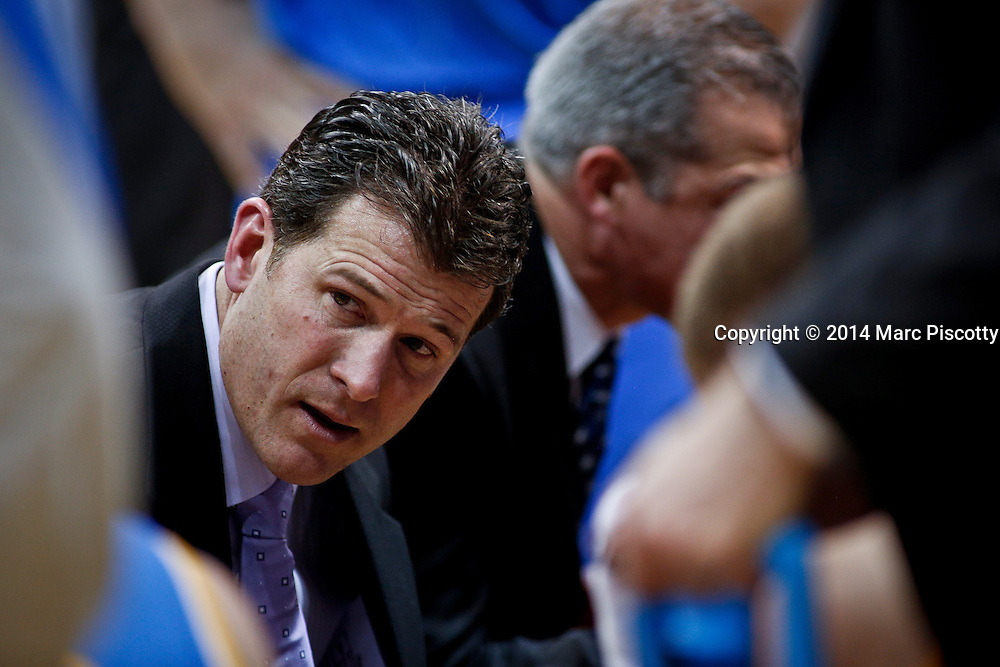 SHOT 1/16/14 8:25:37 PM - UCLA head basketball coach Steve Alford with his team during a timeout against Colorado during their regular season Pac-12 Conference basketball game at the Coors Events Center in Boulder, Co. UCLA won the game 69-56.<br /> (Photo by Marc Piscotty / &copy; 2014)