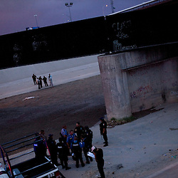 Mexican Federal and Municipal Police and U.S. Border Patrol at the scene of the shooting of a 15 year-old boy, who was killed by a U.S. Border Patrol agent in Ciudad Juarez, Chihuahua on June 7, 2010 after he had tried to cross.