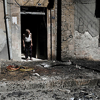 SYRIA, ALEPPO : A man tries to understand what is going on after the building where he lives has been targeted by a mortar in Aleppo, on September 26, 2012. ALESSIO ROMENZI