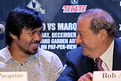 Sept 19, 2012; New York, NY, USA; Manny Pacquiao speaks with promoter Bob Arum during the press conference announcing his fourth fight against Juan Manuel Marquez at The Edison Ballroom.