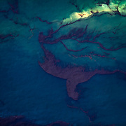 A helicopter flies above Gulf of Mexico water polluted from oil spilled from the BP Deepwater Horizon, May, 2010.