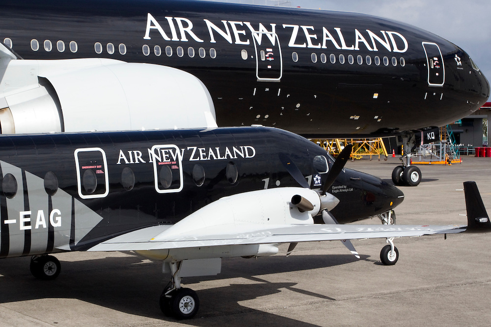 The world's largest black aircraft in Air New Zealand's black paint with a silver fern colour scheme celebrating the All Blacks winning the Rugby World Cup, alongside the smallest, a Beech 1900, at the international airport Auckland, New Zealand, Thursday, January 12, 2012.  Credit:SNPA / David Rowland