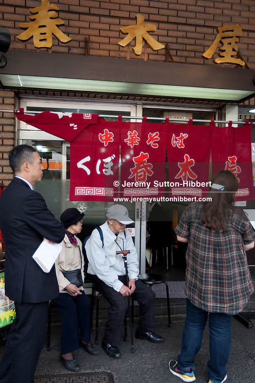 """People queue to enter the very established, very highly regarded and traditional ( or """"old school"""") 'Harukiya' ramen noodle restaurant in Ogikubo district of Tokyo, Japan, Friday 30th April 2010."""