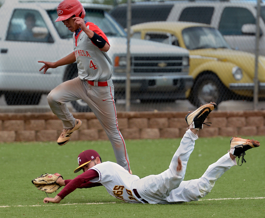 gbs042517i/SPORTS -- Valley pitcher Daniel Romero-Martinez dives and catches the pop fly of West Mesa's Diego Armijo as West Mesa's Gabe Ramirez jumps on his way to home plate in the first inning. Romero-Martinez then caught Ramirez off of third for a double play during the game at Valley on Tuesday, April 25, 2017.  (Greg Sorber/Albuquerque Journal)