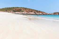 A pristine white sandy beach on the north side of Macleay Island on the Kimberley coast.