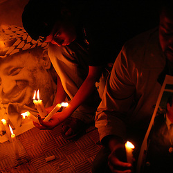 Palestinians start a vigil for Yasser Arafat after news spread that he was suffering from a brain hemorrhage, Gaza, Palestinian Territories, Nov. 9, 2004. Arafat remains in critical condition in a Paris hospital.