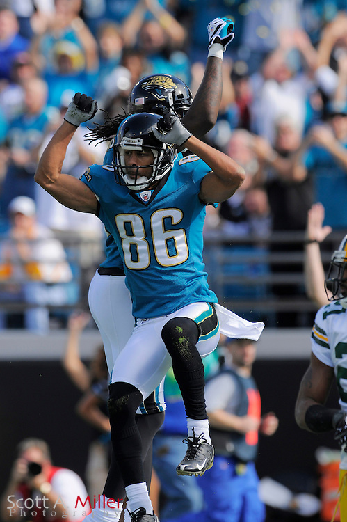 Dec. 14, 2008; Orlando, FL, USA; Jacksonville Jaguars wide receiver Dennis Northcutt (86) celebrates a touchdown with wide receiver Reggie Williams (11) during the first half of the Jags game against the Green Bay Packers at Jacksonville Municipal Stadium. Mandatory Credit: Scott A. Miller-US PRESSWIRE...©2008 Scott A. Miller