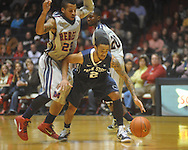 "Ole Miss guard Trevor Gaskins (23)  defends Penn State guard Taran Buie (2) at the C.M. ""Tad"" Smith Coliseum on Friday, November 26, 2010. Ole Miss won 84-71."