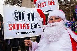 London, December 12th 2014. Porn and sex workers gather outside the Houses of Parliament for a mass sex simulation and face-sitting event in rotest against newly outlawed sex acts in the making of pornography in the UK. Under new Audiovisual Media Services Regulations 2014 rules, such acts as facesitting, spanking and female ejaculation are, among others, now banned from being shown  porn watched online. PICTURED: Bad Santa makes what he wants clear.